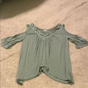 Green shoulder cut out top